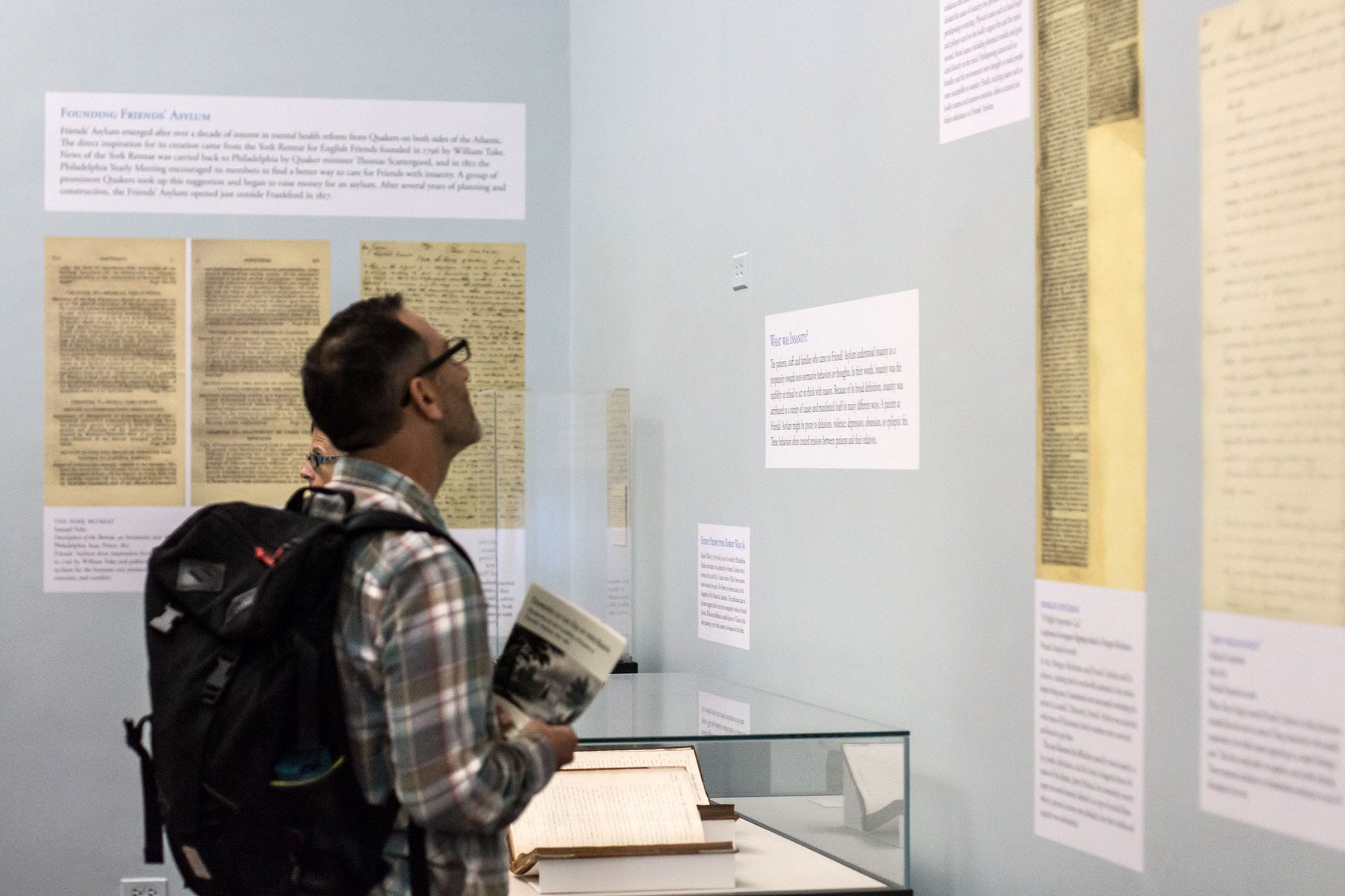 a visitor reads the curators' posted analysis