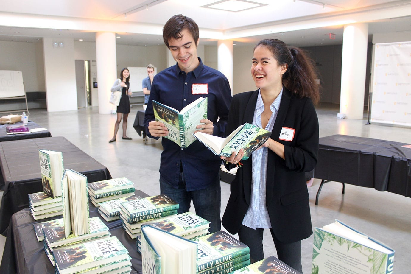 Daniel Bordi '18 and Maelys Gluck '18 check out Gage's book at the conference.