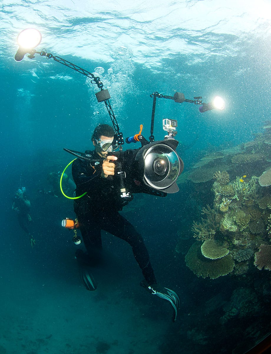 A film still from Chasing Coral showing Director Jeff Orlowski filming on the Great Barrier Reef.
