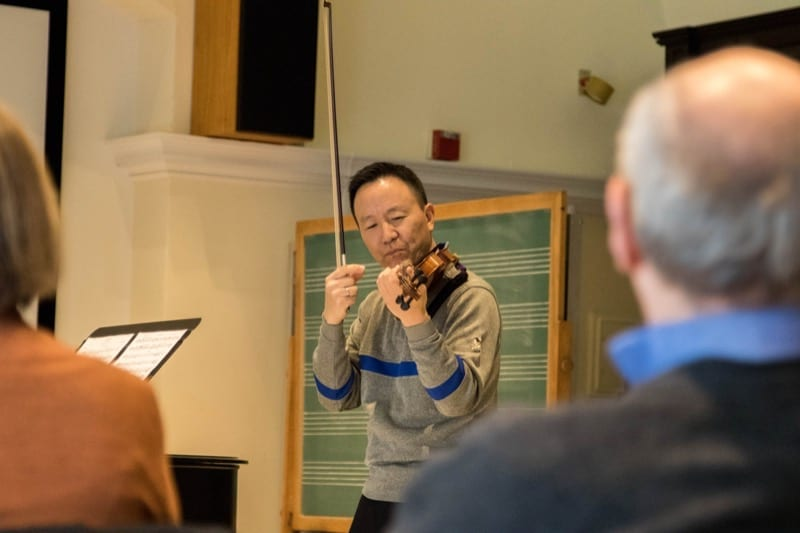 David Kim demonstrating technique to a student.