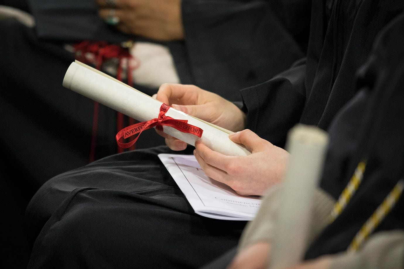 Student's hands holding a diploma