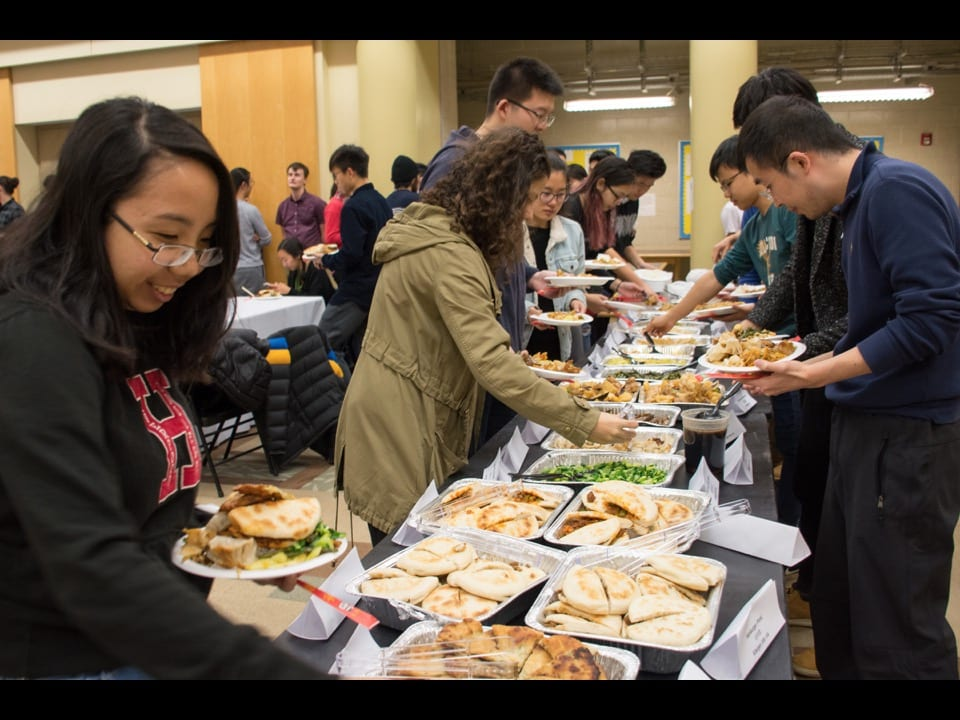 Students load their plates with Chinese food