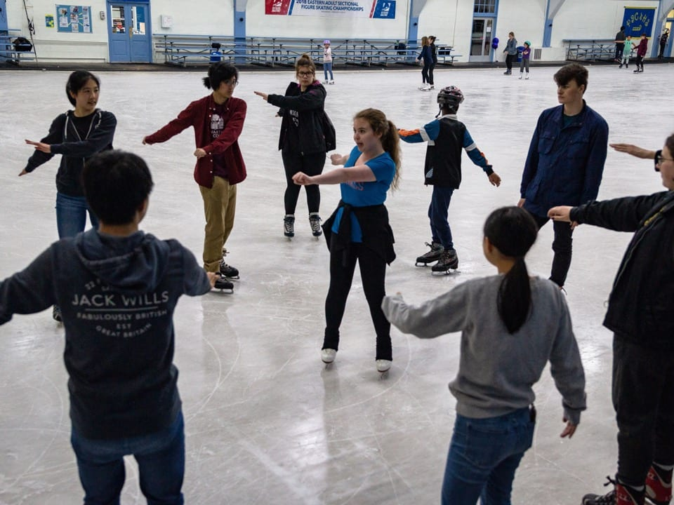 Anna Fiscarelli-Mintz '22 teaching members of the Figure Skating Club some tricks.