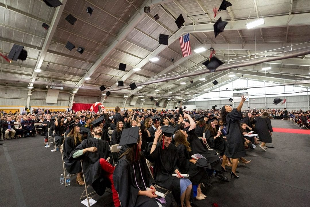 Hats in the air at the Commencement Ceremony in the Field House