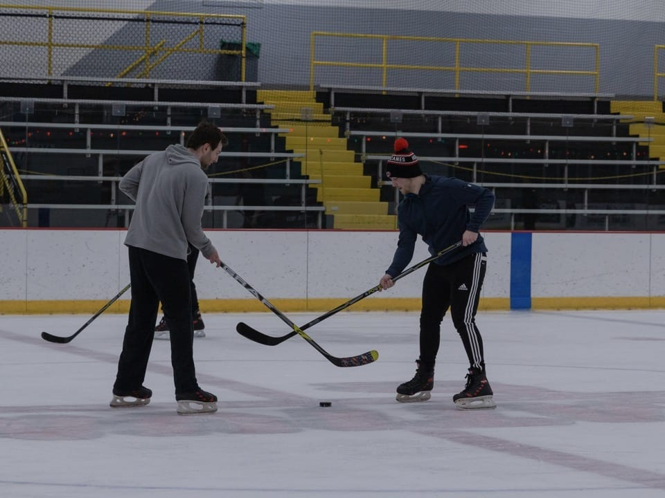 Two players face off on the ice.