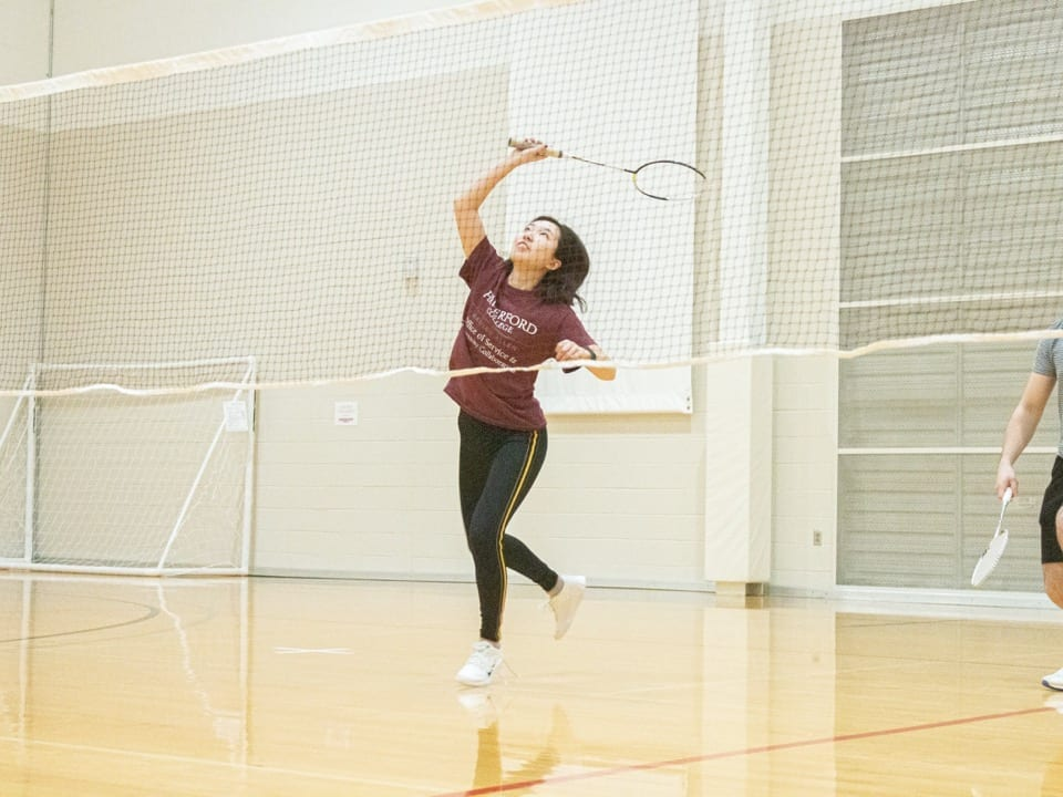 a student playing badminton
