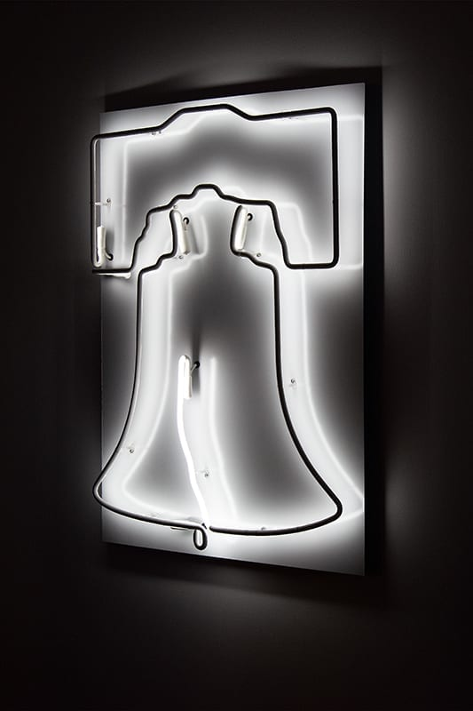 A white neon sculpture of the Liberty Bell