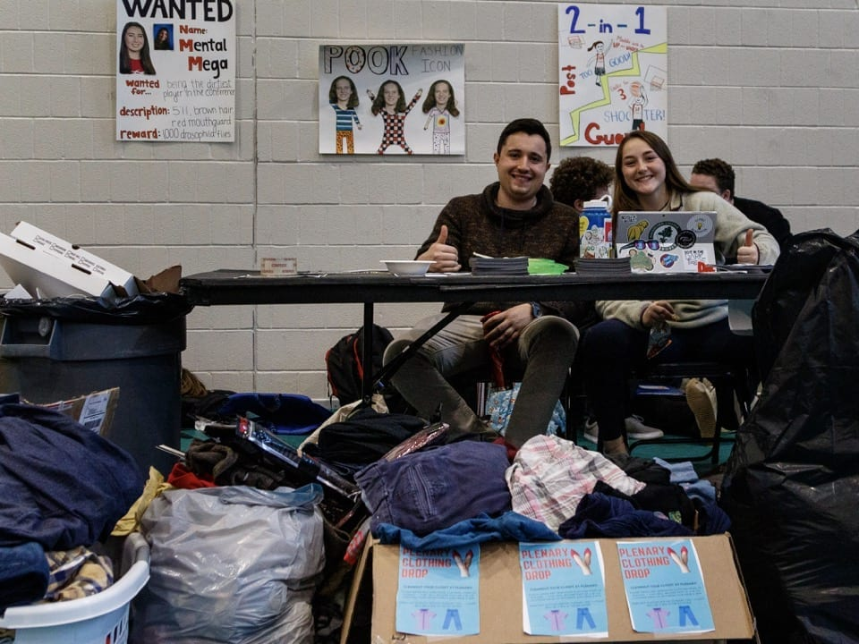 Students collect used clothing for a forthcoming swap.