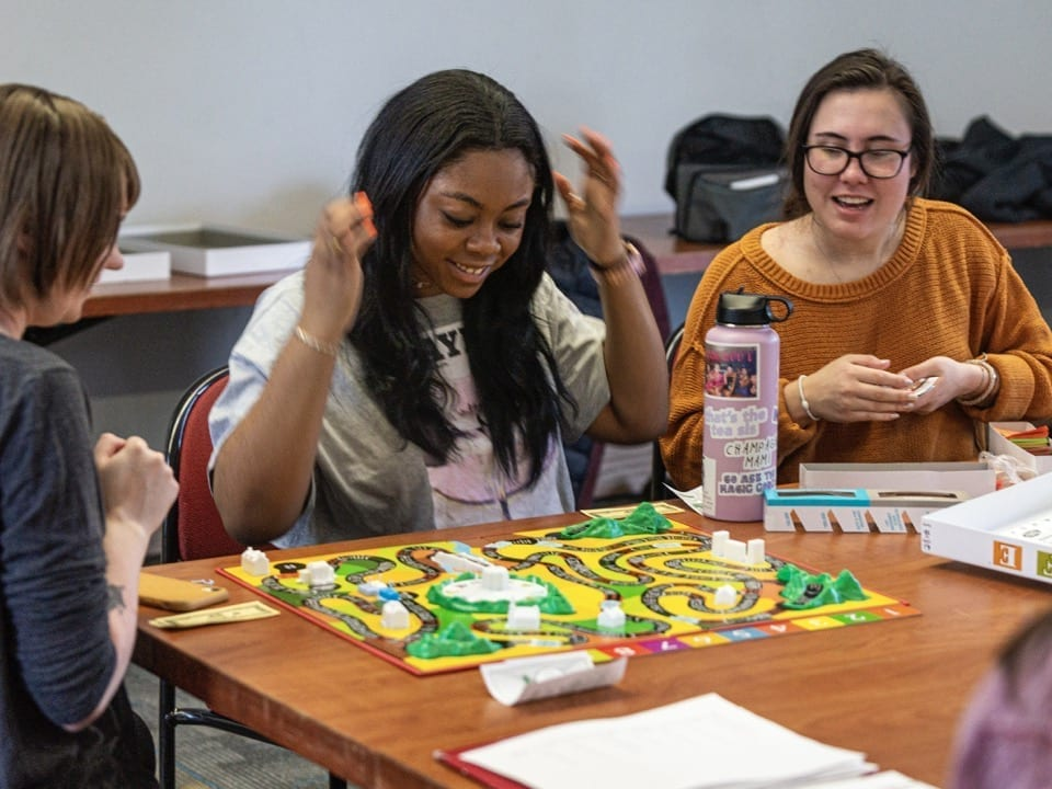A student cheers after her turn at the Game of Life