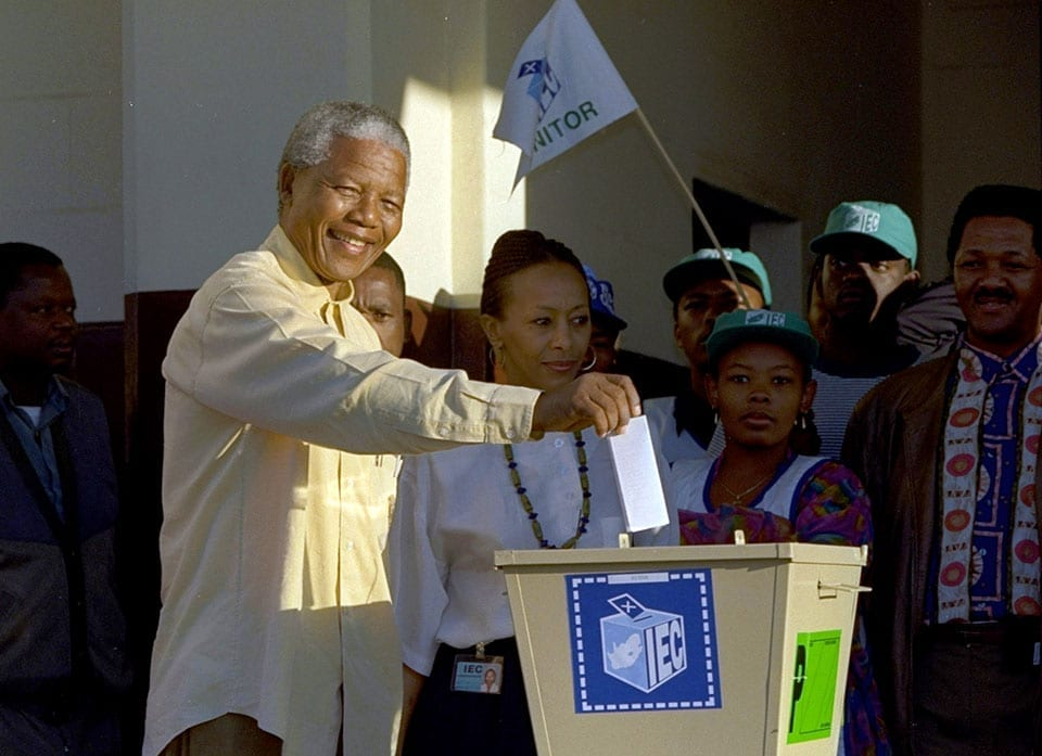 Nelson Mandela casts his vote during South Africa's first all-race elections at Ohlange High School in Inanda.