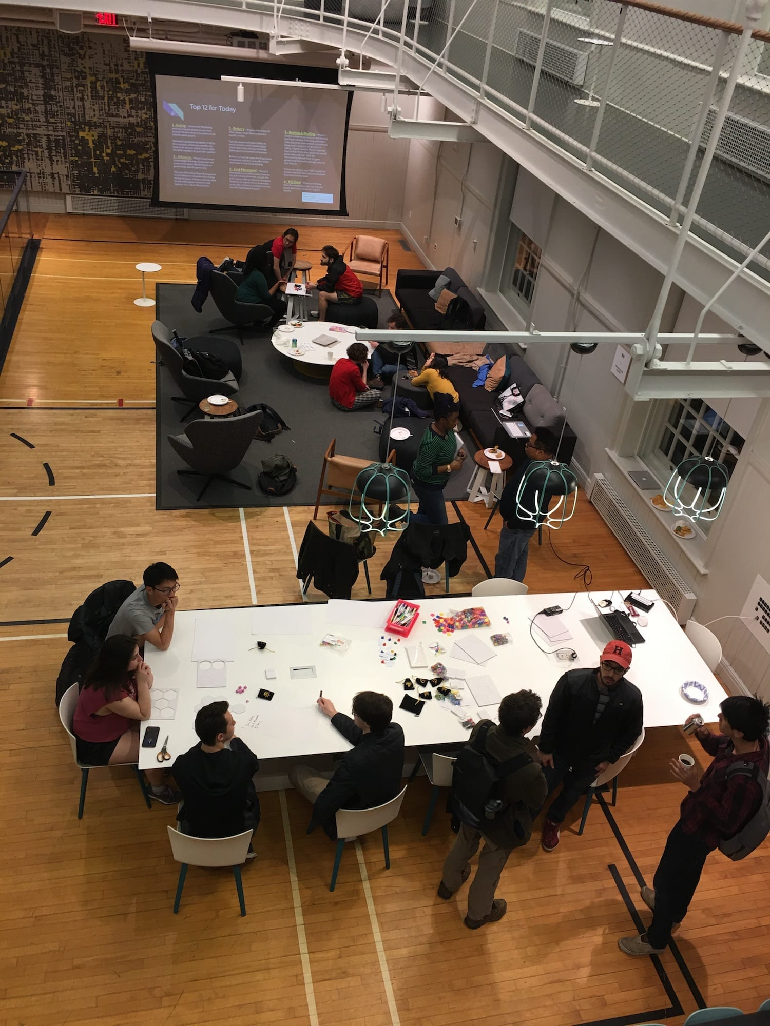 A view from above of students prototyping their original games in the VCAM.