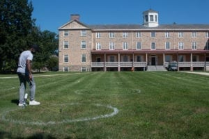Painting circles on the grass outside Founders Hall
