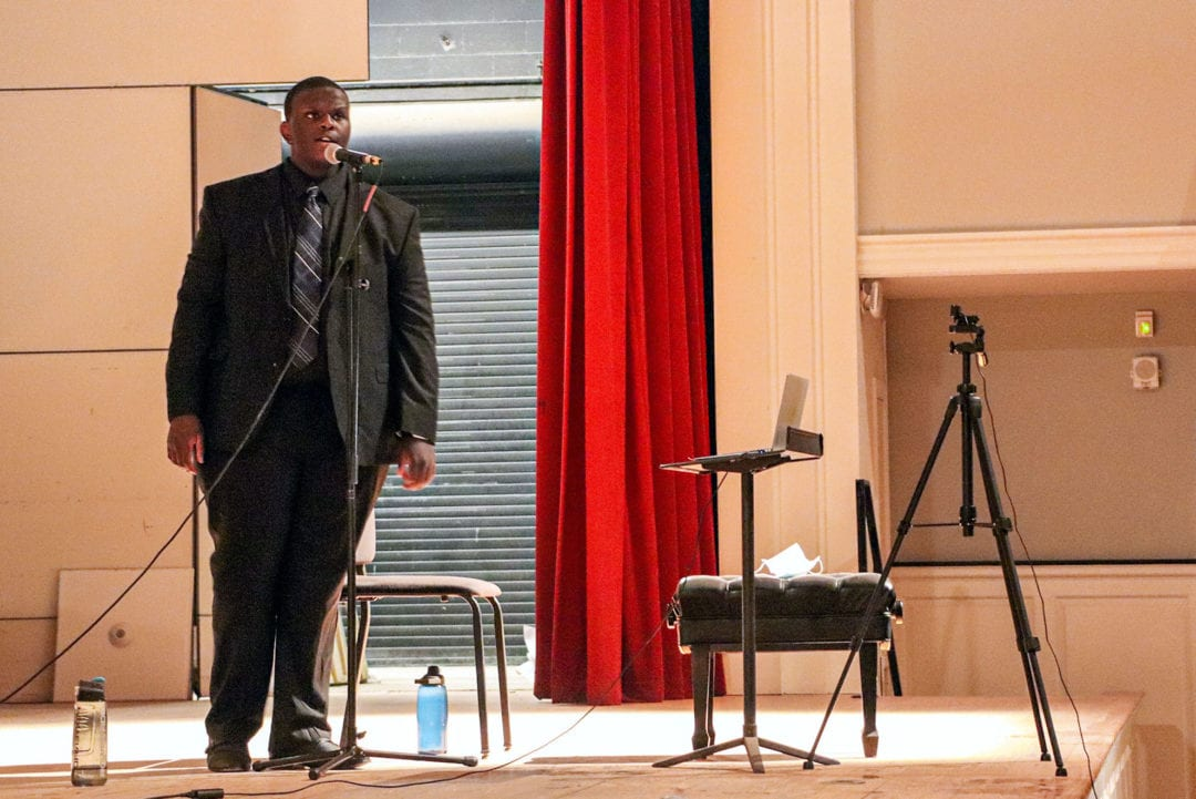 Keith sings on the stage of Marshall Auditorium