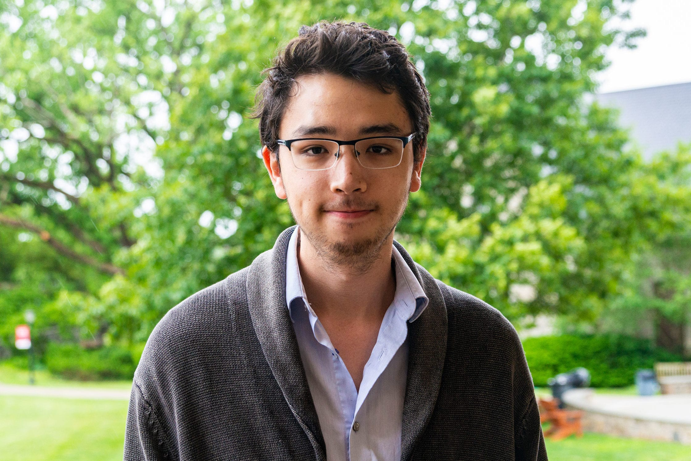 Headshot of Jonathan Sudo in front of trees.