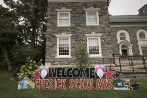 """A lawn sign reading """"Welcome Chesick Scholars"""""""