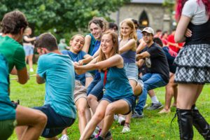 The blue team pulling during a tug of war.
